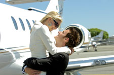 Image of couple hugging outside of plane