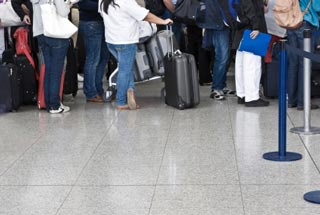 Travellers in line at the airport